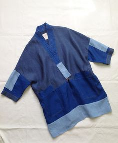 """ LHAMO"" BLUE INDIGO HANDMADE KIMONO COATI made this jacket-coat inspired by my trips to Japan and working several years with handmade traditional japanese kimonos.This jacket-coat is one of a kind piece. Only one piece exists. All details are hand stitched with linen thread. 3 different 100% indigo blue linen fabrics.Coat length 81cm (31.9inches)Without lining.One size.Fits for: 36EUR, 38 EUR and 40 EUR sizes8 UK, 10 UK and 12 UK sizes6 U..."