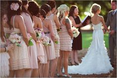 I really love bridesmaids dresses that are the same color but different styles. It's more personal and pretty.