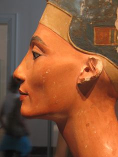 Queen Nefertiti's Bust (ca.1370 BC - ca.1330 BC) created by Sculptor Thutmose, during the historical Egyptian art's rising period of around 1353-1336 BCE. It is now located and displayed in the (Preussischer Kulturbesitz, Agyptisches Museum of Staatliche Museen) zu Berlin, Germany.