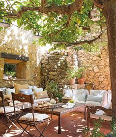 Gorgeous rustic patio with rock wall