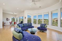 Mountain Views Majesty!  Views from this novelty property command the entire home.  Splendor & function merge into panoramic views of Four Peaks, McDowell Mtns and the Famous Fountain Hills Fountain.  Highlighting true indoor/outdoor living, this private resort style home boasts an ''Owned'', not leased,  4.3 KW SOLAR SYSTEM resulting in MINIMAL UTILITY COSTS.  Soaring ceilings accentuate the expansive living room which opens to an airy bistro balcony.  Family & Entertainment area flow with…