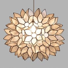 Handcrafted by skilled artisans in the Philippines, our dramatic pendant features white capiz seashells formed into a gorgeous flower ball. The naturally harvested shells glow with a warm radiance when illuminated, creating a soothing ambiance. Pair this chic shade with any of our electrical cord swag kits to create a custom look that's ready to light up a room.
