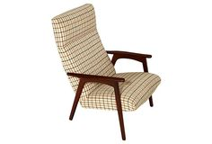 Now that's a good-looking lounge chair—teak legs and original upholstery. So #madmen.