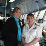 On the ships: photo of Carrie Finley-Bajak and Cunard Line Captain Inger Olsen.