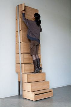 Vertical storage! The three bottom drawers serve as a staircase and there's even a side rail for secure climbing.Design made by Danny Kuo.
