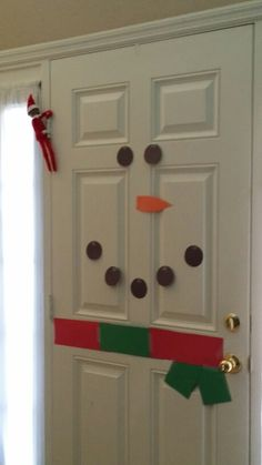 Elf on the shelf idea   Snowman on the door
