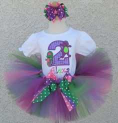 The perfect outfit for your little Barney The Dinosaur fan. Your little  one will steal the show when wearing this BARNEY and Baby Bop Number Tutu Set! Fun colors and your favorite characters combine to create a wonderful birthday outfit. Add your child's name for an added touch!  The tutu is full and fluffy. This super sesame street themed birthday tutu set will be perfect for your little girls birthday party! The full set includes a personalized onesie or shirt with a 8.5 tutu a