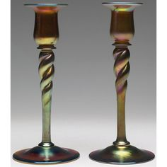 Steuben candlesticks, pair, gold Aurene glass with a twisting stem and overall iridescence