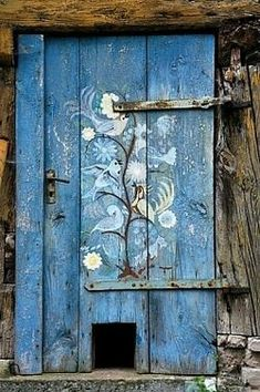 Beautiful painted door. Complete with small pet egress. #house