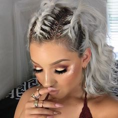 Braids with glitter by @jaxvicious _____________________________ Used @lemonhead.la glitter to create this hairstyle. You can use it for the body and eyes too. @goldsoulla ring set @artistcouture Diamond Glow Highlight in Conceited and Coco Bling