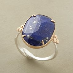 LONE LAZULI RING--A faceted lapis, held in a 14kt gold pronged bezel, steals the spotlight on this sterling silver ring by Emily Amey. USA. Exclusive. Whole sizes 5 to 9.
