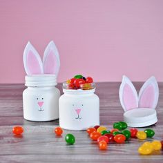 Mini glass jars, paint, and felt make up these adorable Easter Bunny candy holders!
