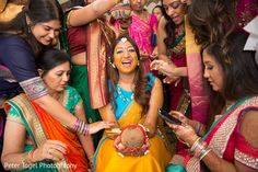 Indian Bride Is Smeared In Yellow Turmeric Paste At Her First Wedding Ceremony Ritual