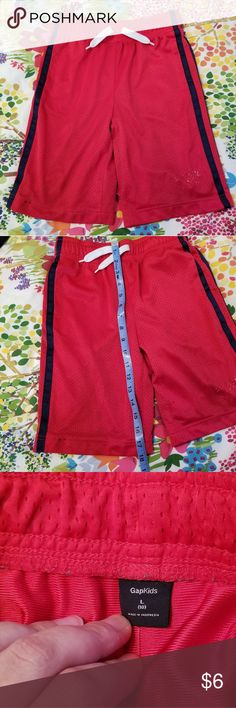 GAP athletic shorts GAP boys athletic shorts in red with black stripe. Small stain on bottom hem and whatever used to be on the front is worn away. BUT otherwise they are good shorts - well made and perfect for an active little boy. Size is a 10 but my son is husky and he wore these when he was 8. Happy to bundle with other shorts. GAP Bottoms Shorts