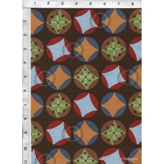 Starburst brown fabric is playful yet bold, with its colorful toy jacks displayed in an interesting geometric design. Quilt Cotton Fabric. www.americasbestthreads.com
