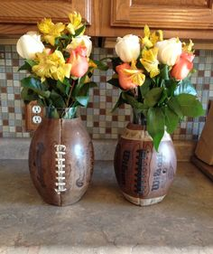 Football banquet coaches table center pieces. I love this idea!