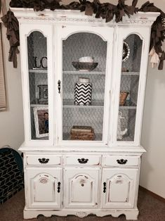 Broyhill China cabinet hutch given a chalk painted shabby chic update. Chicken wire in place of glass, gray & white tones, light distressing. #shabbychiccabinets