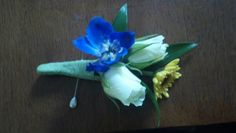 Boutonniere: White Spray Roses with delphinium and viking mum