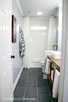The bathroom renovation is done! (And amazing!) - The bathroom renovation is done! (And amazing!) Idea for upstairs hall bath…Love the large tile floor and the open storage in the sink area. Grey Bathroom Floor, Mold In Bathroom, Hall Bathroom, Upstairs Bathrooms, Bathroom Renos, Bathroom Flooring, Bathroom Renovations, Master Bathroom, Bathroom Ideas