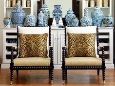 Bobbin chairs remain very popular and these look terrific with the leopard pillows and accessorized with all the blue and white ceramics.