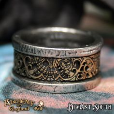 Alchemy Gothic AG-R44 Dr. von Rosenstein's Induction Principle Ring  A steampunk and gothic standard, pewter and solid brass band ring with pierced and etched brass detail.