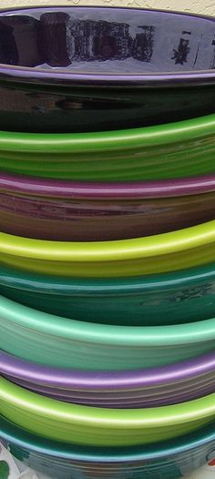 Fiestaware colors from the bottom up - Juniper, Chartreuse, Lilac, Seamist, Evergreen, Lemongrass, Heather, Shamrock, Plum.
