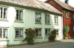 Lovely street view from an old Swedish small town, Vadstena. Lots of geraniums in the windows and roses by the street. Geraniums, Small Towns, Street View, Windows, City, Outdoor Decor, Roses, Meet, Home Decor