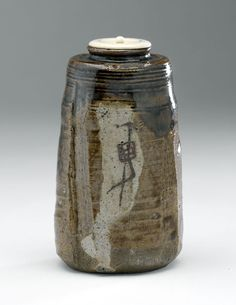 Mino (Oribe) ware cha-ire (tea caddy) with futa (lid)  Oribe type, Mino ware.  Glazed stoneware with ivory lid  Centimetres: 10.8 (height), 6.1 (outside diameter)  late 17th to 18th century AD  Early Modern; Edo  Area of Origin: Japan. ROM Images