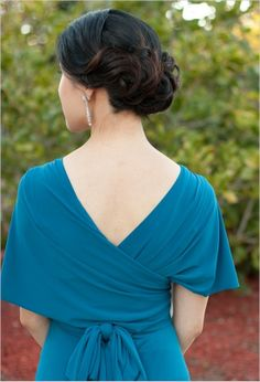wrap dress for bridesmaids - great color, love her hair too!