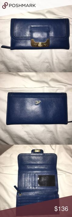 """Authentic DVF Navy Leather Wallet Authentic Diane Von Furstenberg Navy Leather Wallet. Gold hardware on front closure. Has a change purse that zips, several slots for credit cards and business cards, a clear pouch for storage of your identification, and space for your checkbook. Measures 7 3/4"""" x 4 1/2"""". Brand new, never used. Diane von Furstenberg Bags Wallets"""