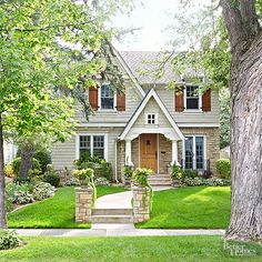 A charming facade doesn't require a full-out facelift. Utilize the weekend to carry out one or all of the key details featured in this home's front yard. Stone pillars anchor a winding walkway that leads to an updated front door. Tailored landscaping provides the perfect setting for custom trim and a classic color palette./