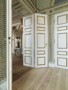 After extensive restoration of the royal Frederik VIII's Palace the Danish Crown Prince Couple moved into a modern home with new Dinesen wooden plank floors and artworks.