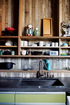 Architect John Tong's kitchen with reclaimed wood cladding