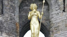 A 20ft sculpture of Dame Shirley Bassey in a Boudicca pose is unveiled at Caernarfon Castle to launch a series of arts events across Wales.