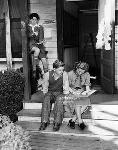 Mickey Rooney (1920 -), the child actor, seen here with Betty Jaynes at the MGM school between takes. Ronald Sinclair sits in the background.