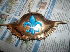 crabshell ornaments...We made a lot of these for our Saints Tree...We painted them gold with black Fleur De Lis...Connie ( our trees are black)