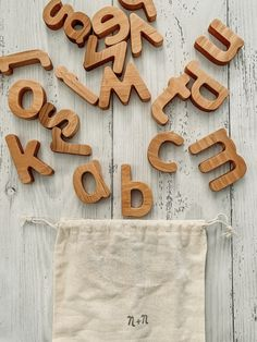 Beautifully handmade in Ukraine comes this handcrafted wooden alphabet exclusively made for Nestling & Nook! Help your little onewith their alphabet, their spelling and all things literacy with this beautiful 26 piece alphabet set. Available in both Lowercase and Uppercase options. This set is made from eco wood,