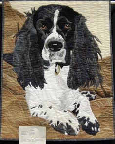"""Carol Deards says, """"Raw edge applique portrait designed from a photograph. Created from commercial cotton fabrics. Satin stitched to add detail."""" Carol did a great job on this lifelike depiction of her dog's facial features, especially Roxie's eyes and ears."""
