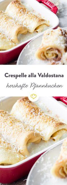 Ein wunderbares Gericht aus den italienischen Bergen: Herzhafte Pfannkuchen mit Fontinakäse und Schinken gefüllt und im Ofen gebacken.