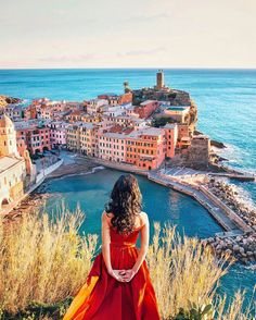 Vernazza Cinque Terre Italy... Photo from @brahmino! The Beauty in Vernazza on a sunny day with a lady in red. Wish you have a great weekend! Check the tagged profiles for amazing Italy photos!