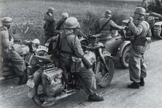 A group of Fallshirmjagers with their BMW R71  motorcycles along with a rare TWN bd 350 in the background
