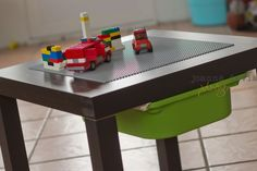 Ikea LACK Lego hack.  Total $30 1 LACK side table from IKEA ($7.99)  1 TROFAST bin from IKEA ($3.99)  1 LEGO play plate from Target ($12.99)  Loctite Stick N Seal (you can also use Earthquake Putty) ($3.29)   While youre at IKEA, you need to go to the Returns desk and ask if you can purchase (or have) a set of the TROFAST rails. They are plastic. At my IKEA they gave them to me.  Total $30