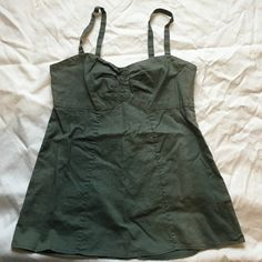 Patagonia Tank Beautiful, fitted Patagonia Tank.  Zips up in back and has adjustable button straps. Little bit of discoloration but still in great shape! Patagonia Tops Tank Tops