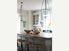 Blue glass pendants, rough edge stone: coastal vibe by Tammy Connor Interior Design