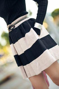 Neutral palette - striped skirt, black long sleeve top, studded skinny belt, gold bangle and nude heels.