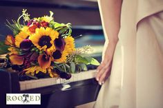 Leon's beautiful bridal bouquet of sunflowers,callas, bear grass, hypericum and seeded euc  Photo by Morgan Trinker