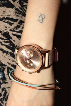 Triwa NEST105 - Simply stacked! Rose Tan Nevil is a metal masterpiece with a touch of genuine leather. - SavvyWatch.com