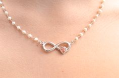 Jennifer Rodrigues Designs Hand Carved and cast Bermuda Pink Sand and Sterling Silver Infinite love pendant with fresh water pearls.