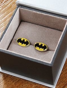 Batman Cuff Links. For my husband on our wedding day... That's right, you heard me.. I'm making bat man part of my wedding :)
