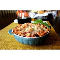 Simple layers of cooked ground beef, ready-made spaghetti sauce, rotini pasta and mozzarella cheese bake into a quick and easy meal.